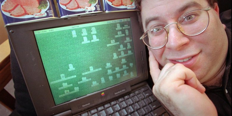 "FILE - Sanford Wallace, president of Cyber Promotions, poses with his computer and cans of Spam processed meat in Dresher, Pa, in this May 8, 1997 file photo. Wallace, the self-proclaimed ""Spam King,"" pleaded not guilty during an initial court appearance Thursday Aug. 4, 2011 after being indicted July 6 on six counts of electronic mail fraud, three counts of intentional damage to a protected computer and two counts of criminal contempt. The indictment filed in San Jose federal court said Wallace compromised about 500,000 Facebook accounts between November 2008 and March 2009 by sending massive amounts of spam through the company's servers on three separate occasions. (AP Photo/Dan Loh)"